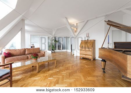 living room with fishbone parquet and piano in beautiful apartment home