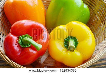 variety of colorful Bell pepper or sweet pepper in wooden basket