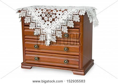 wooden chest of drawers for jewelry covered with lacy napkin