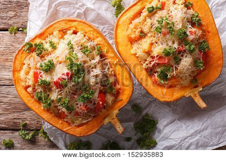 Half Baked Pumpkin With Couscous, Meat, Vegetables And Cheese Close-up. Horizontal Top View