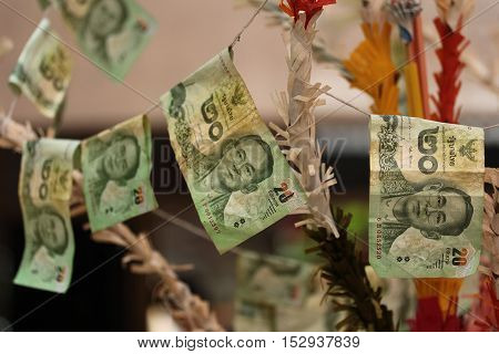 Buddhists make merit,Sticked cash the merit tree  at temple. . Selective focus.