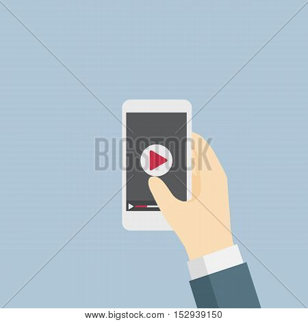 Businessman holding a mobile phone and going to watch video