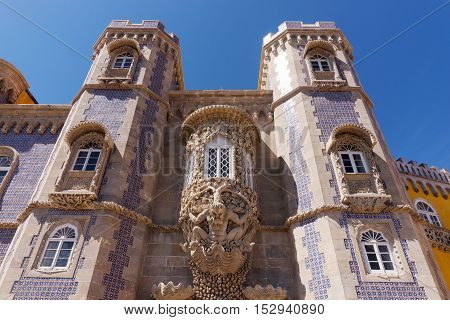 Triton over the lancet arch, Pena National Palace, Romanticist palace in Sintra
