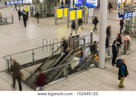 Utrecht The Netherlands - October 12 2016: Central hall of NS Central Railway Station Utrecht with walking and waiting people and an escalator The Netherlands.