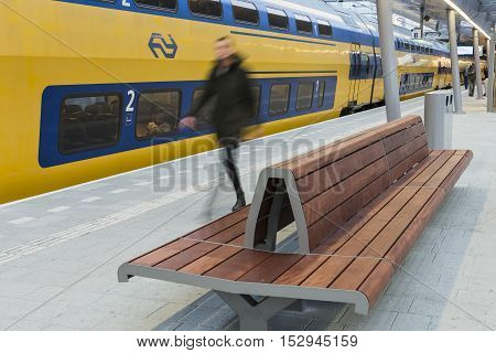 Utrecht The Netherlands - Ocotber 12 2016: NS Central Railway Station Utrecht with walking people at the platform with train and bench The Netherlands.