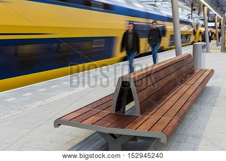 Utrecht The Netherlands - October 12 2016: Central hall of NS Central Railway Station Utrecht with walking people on platform and bench The Netherlands.