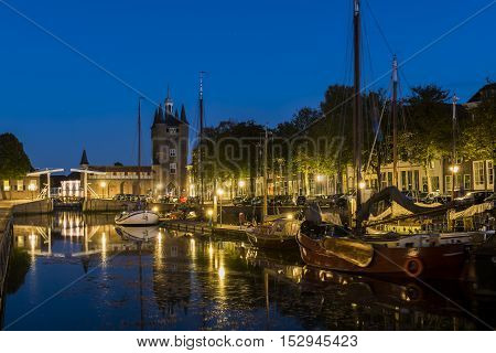 Zierikzee The Netherlands - October 5 2016: Harbor with old ships and Zuidhavenpoort at night at the Oude Haven in Zierikzee in Zeeland The Netherlands.