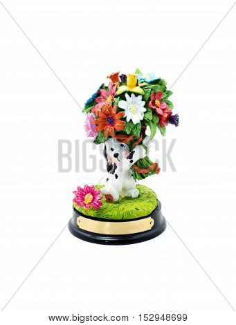 Funny ceramic dog with flowers on a white background. Space for your text. Happy Birthday.