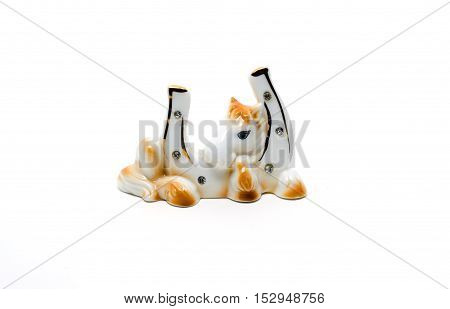 Ceramic a statuette a horseshoe isolated on white. Good Luck Symbol.