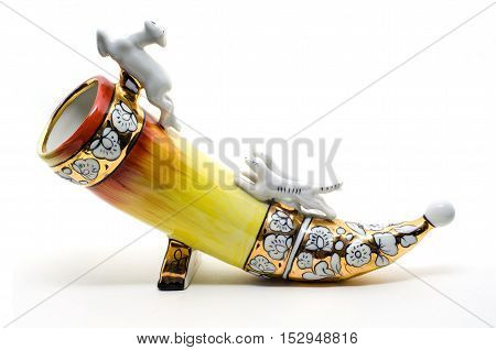 Ceramic Drinking horn isolated on white. Modeling Dogs pursue deer.