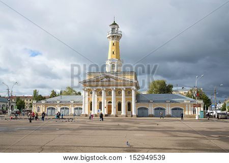 KOSTROMA, RUSSIA - SEPTEMBER 16, 2016: View of the old firehouse building with the watchtower. Susaninskaya square in the historic centre of Kostroma