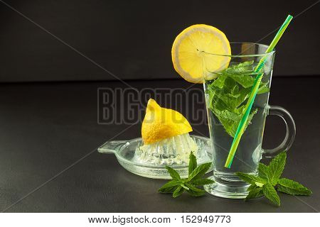Refreshing mint and lemon. Homemade lemonade with fresh lemon and mint. Mint julep in glass on the wooden background.
