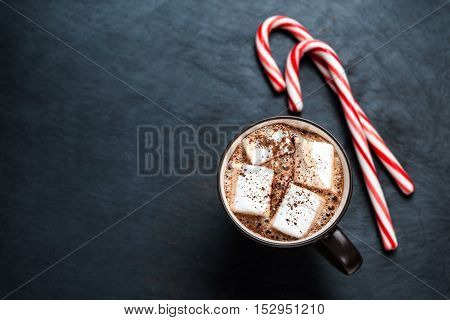 Hot Chocolate with marshmallows and candy stick traditional beverage for winter time
