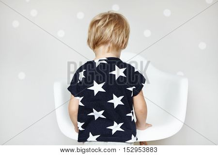 Little Playful Caucasian Boy With Blonde Hair Dressed In T-shirt With Stars, Playing With His Toys I