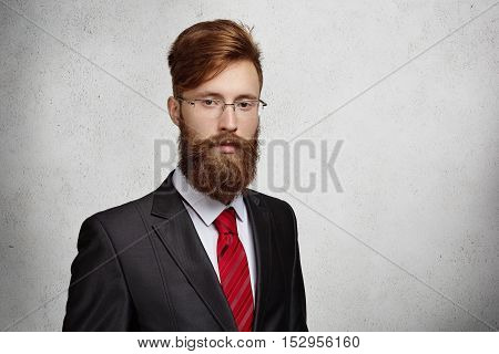 Good-looking Stylish Redhead Entrepreneur Or Office Worker With Thick Beard And Rectangle Glasses Po