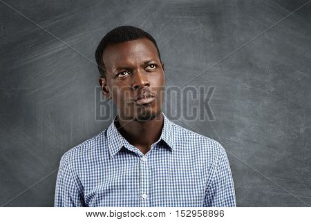 Close Up Portrait Of Dark-skinned Student With Pensive And Concentrated Expression Trying To Recolle