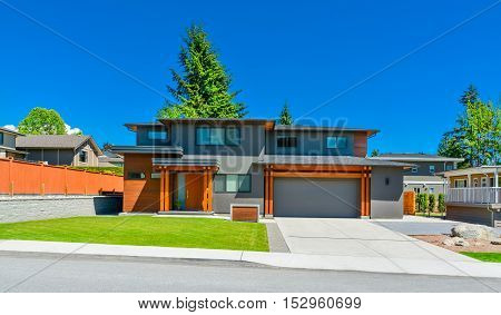 Newly renovated family house in Vancouver British Columbia. Residential house with wide garage door and concrete driveway