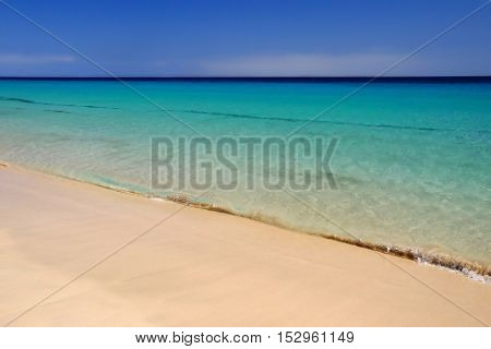 View on the beach with crystal sea water in Morro Jable on the Canary Island Fuerteventura Spain.
