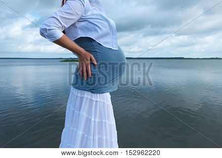 Pregnant Woman, Blue Asky And Beautiful Water