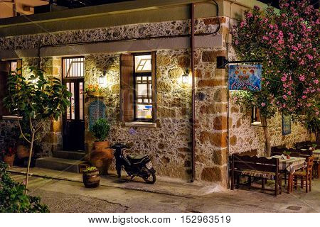 PALEOCHORA, CRETE, GREECE - JUNE 2016: Night view of traditional greek tavern in Paleochora town on Crete island