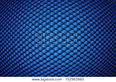 Blue convex synthetic fiber texture with vignette.