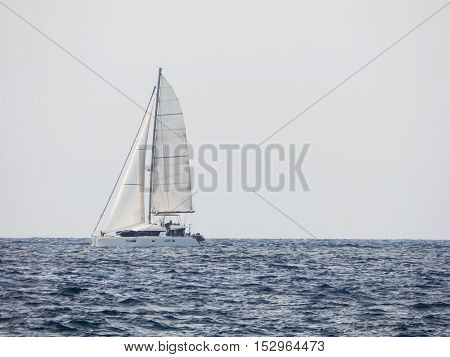 Sailboat floating on sea of Sicily, Italy