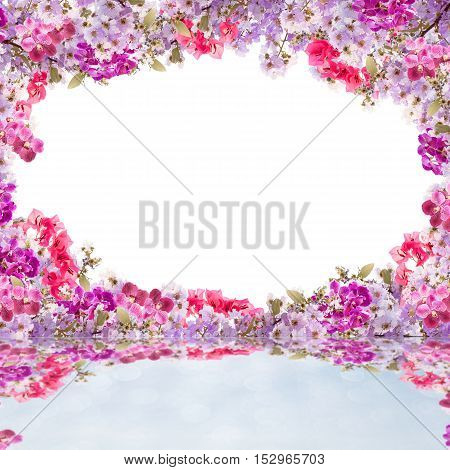 Beautiful leaves frame with flower on white background with reflection