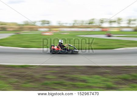 Super kart racing team. The racer on carting. Races on a cross-country terrain. Cars races. Races on long exposure.