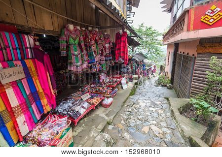 Sa Pa Vietnam - September 18 2016: Walkway surrounded by local shops sell a local gift and souvenir in Cat Cat village of Sa Pa Vietnam.