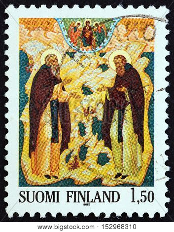 FINLAND - CIRCA 1985: A stamp printed in Finland issued for the centenary of Saint Sergei and Saint Herman Order shows Saints Sergei and Herman (icon, Petros Sasaki), circa 1985.