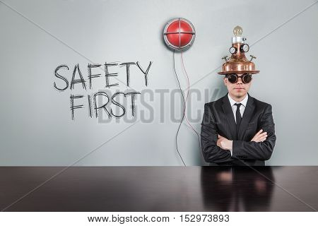 Safety first text with vintage businessman and alert light