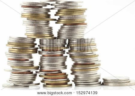 Stack of coins isolated on white backgroundconcept of business planning and finance and savings