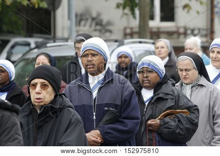 BUCHAREST ROMANIA - OCTOBER 23 2016: Catholic nuns are praying during the Eucharistic procession with the relic of Saint Pope John Paul II.