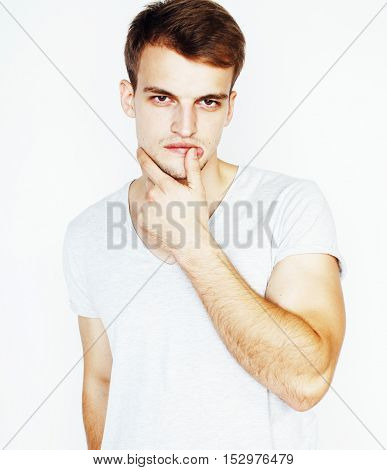young handsome man on white background gesturing, pointing, posing emotional, cute guy sexy, lifestyle people concept close up