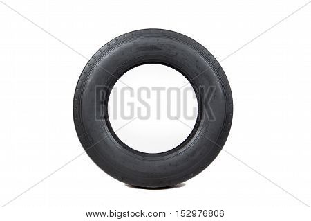 Car tire isolated on white background. Truck tire isolated. Dump tire isolated.