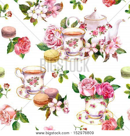 Tea pattern with flowers cherry blossom, rose flower , tea cups and macaroon cakes. Watercolor. Seamless background