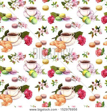 Tea or coffee pattern with flowers, croissant, tea cups and macaroon cakes. French style watercolor. Seamless pattern