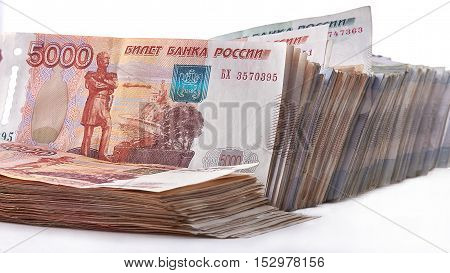 Bundle of rubles, a lot of money as background.
