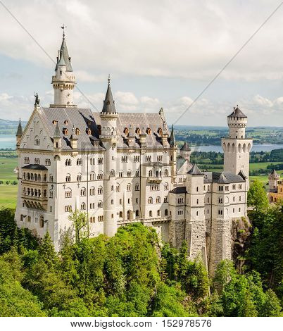 Neuschwanstein Castle is a nineteenth-century Romanesque Revival palace on a rugged hill near Fussen in southwest Bavaria Germany.