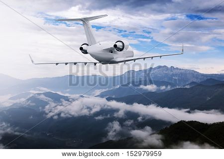 Airplane Flying Near High Mountains And Clouds