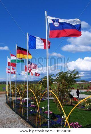 Flags Flying Against Blue Sky