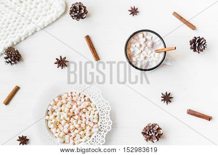 Christmas. Winter. Hot chocolate cinnamon sticks anise star marshmallow knitted blanket and cones. Christmas composition. Flat lay top view