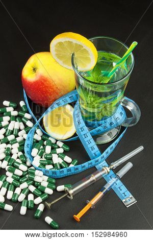 Diet concept. Treatment of obesity. Strict diet. Fruits like diet food.