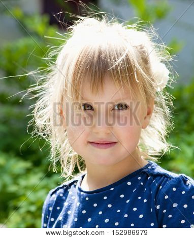 Portrait of a Beautiful Little Girl with Blond Hair