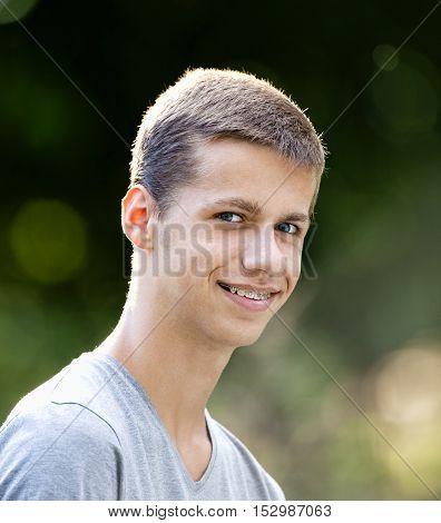 Portrait of a Teenage Boy with Braces