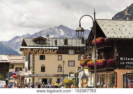 Livigno, Italy - August 1: Tourists Shopping On The Streets Of Duty-free Area On 1 August 2016 In Li