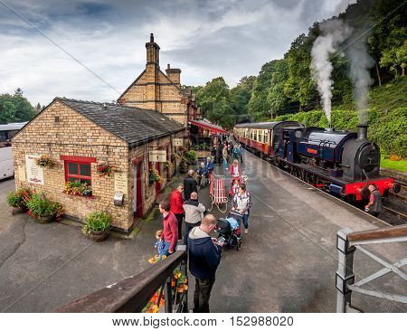 Haverthwaite England - October 4 2016 - Tourists waiting at Haverthwaite Station part of Lakeside and Haverthwaite Railway. The steam train runs between Haverthwaite Station and Lakeside Windermere South Lakeland Cumbria England UK.