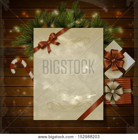 Christmas background with paper ribbon and lights on a wood wall with gift boxes candy cane and in grange photo type