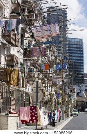 Drying clothes on the balcony. Clothes hanging on washing line outside balcony, Shanghai, China