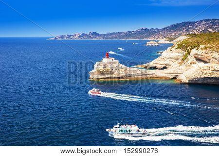 Lighthouse near Bonifacio on beautiful white rock cliff with sea bay Corsica France Europe.
